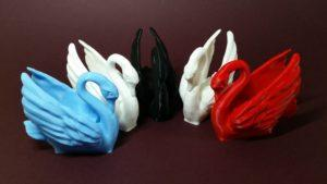 Odile The Swan in White, Black, Blue and Red