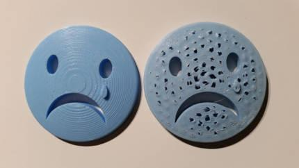 3D Printed Sad Face Widget Picture